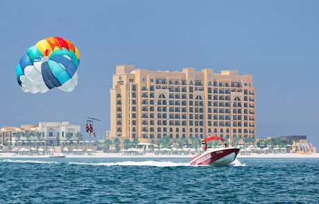 Person parasailing at Doubletree by Hilton Resort Marjan Island
