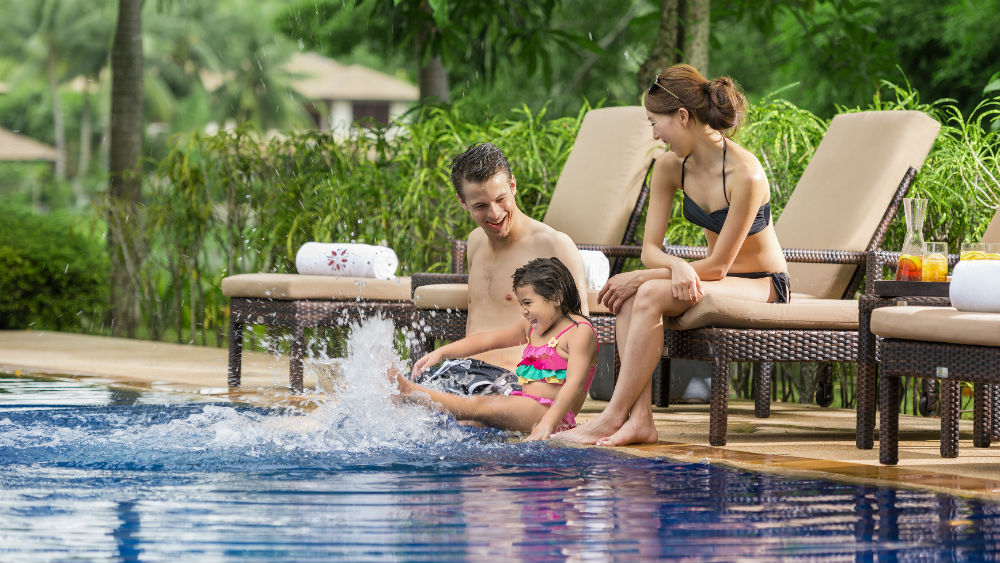 Family at swimming at the Pool at the Angsana Laguna Phuket