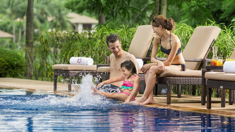 Family at swimming at the Pool at the Angsana Laguna Phuket