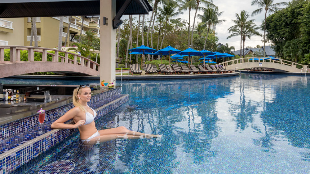 Woman in bikini at pool bar at Angsana Laguna Phuket