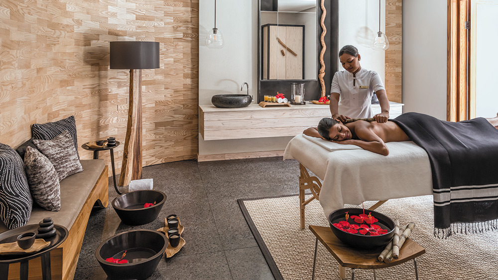 Woman getting a massage at Shangri-La's Le Touessrok Mauritius