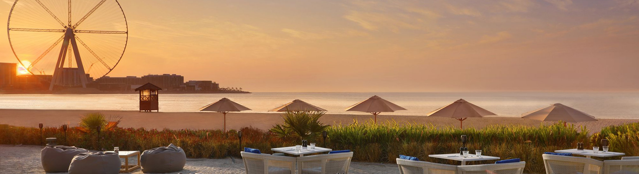 Outdoor dining at sunset at Ritz-Carlton Dubai
