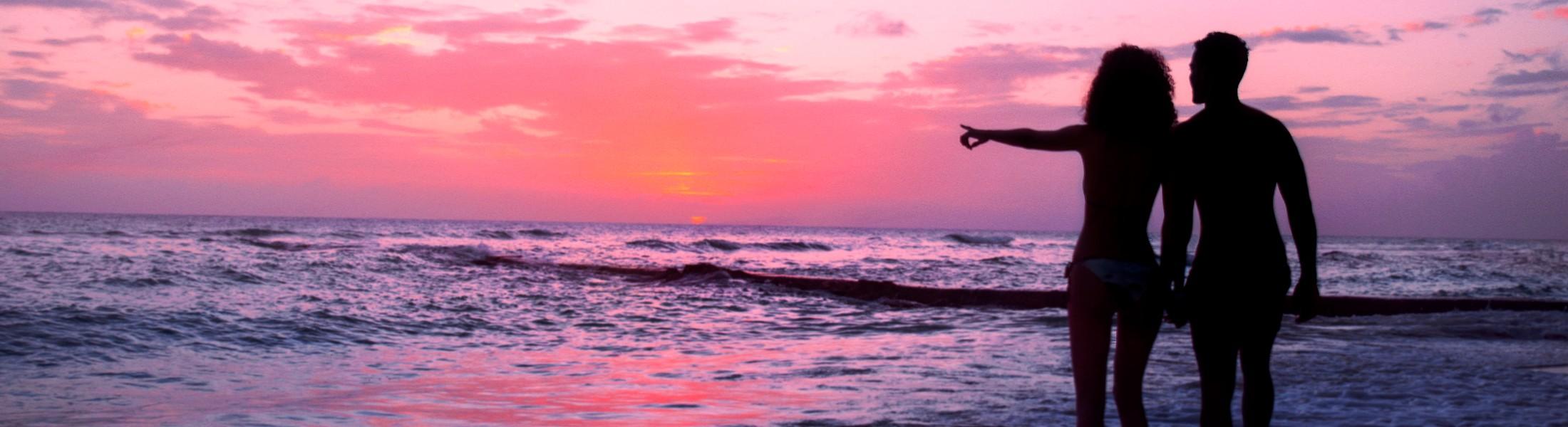 Couple on the beach at sunset at Sugar Bay Barbados