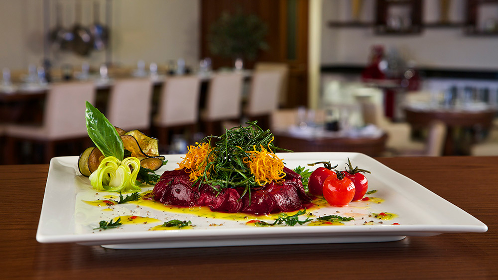 plate of food at Vespa Restaurant at Doubletree by Hilton Resort Marjan Island