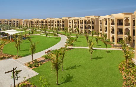 Grassed area in front of villas at Doubletree by Hilton Resort Marjan Island