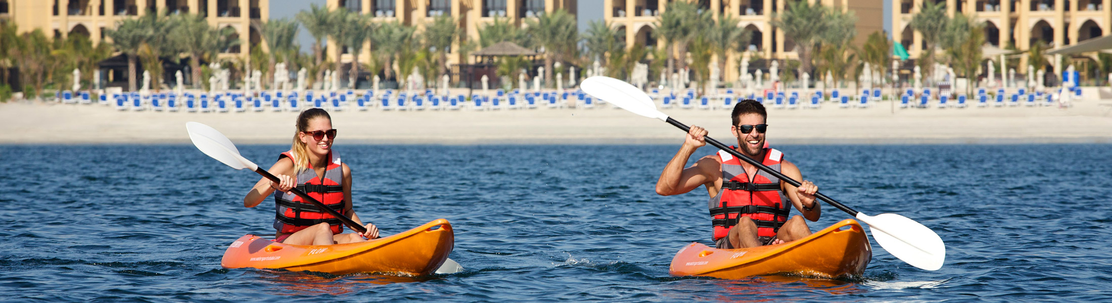 Couple kayaking at DoubleTree by Hilton Marjan Island