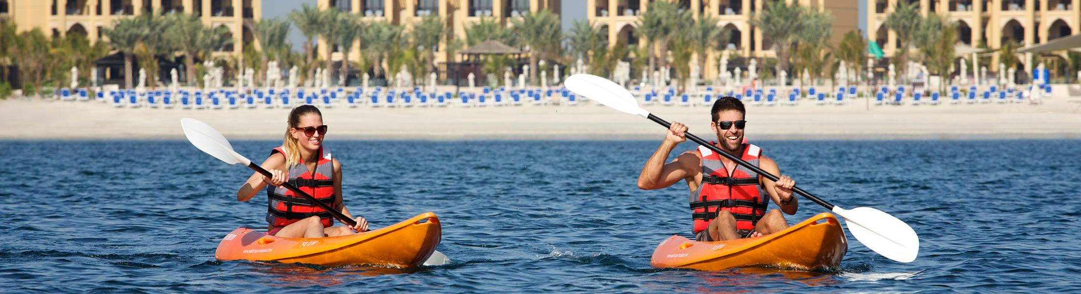 Couple kayaking at DoubleTree by Hilton Marjan Island
