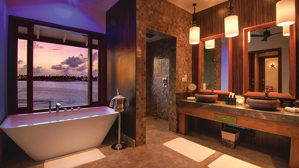 Bathroom overlooking the water at Oblu Select at Sangeli