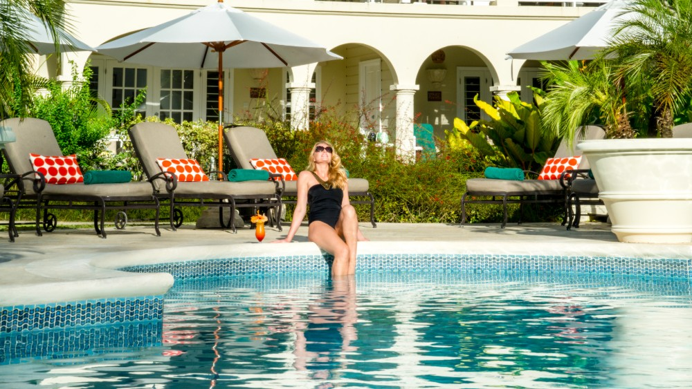 Woman by the pool at Coral Reef Club in Barbados
