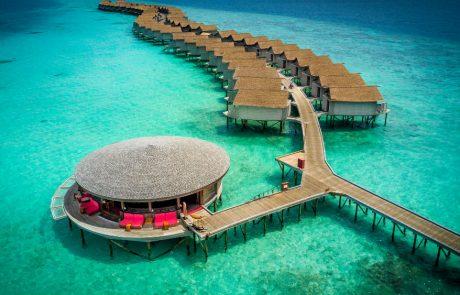 lounge area and villas at the Centara Ras Fushi Resort and Spa Maldives