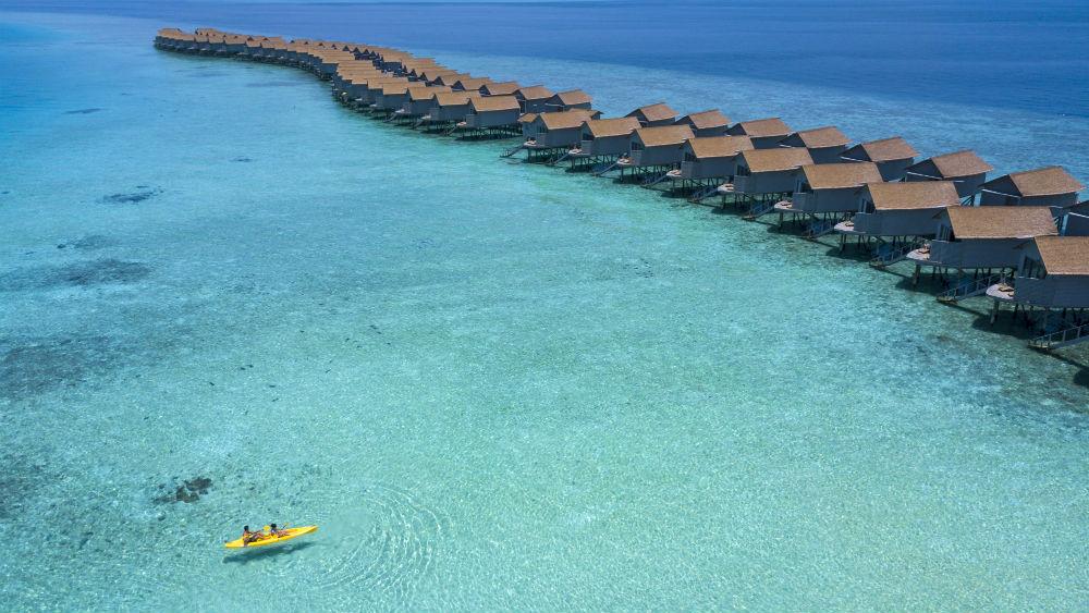 sea canoe and water villas at the Centara Ras Fushi Resort and Spa Maldives