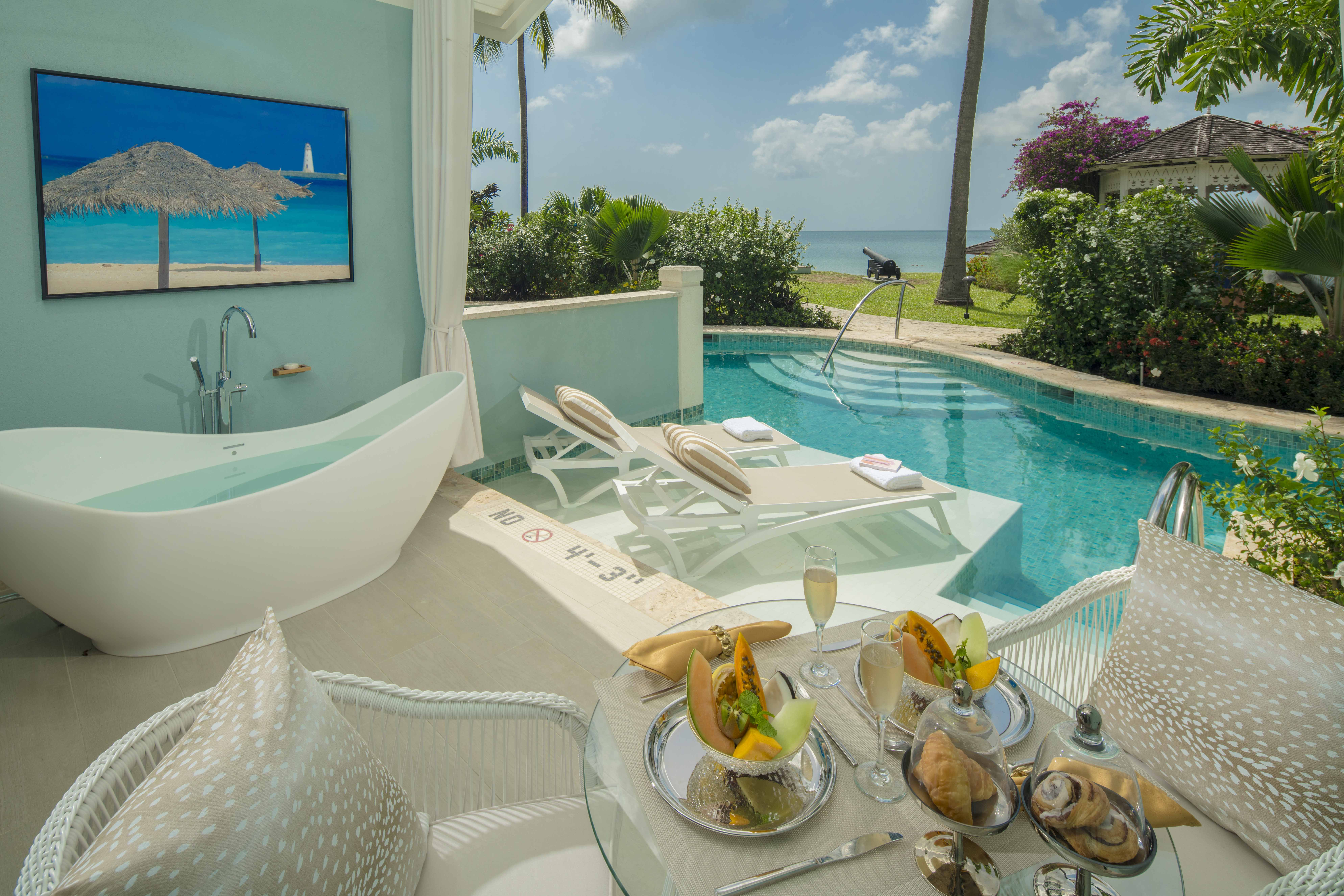 Beachfront Crystal lagoon Swim-up Butler Room w Patio Tranquility Soaking Tub at the Sandals Halcyon Beach