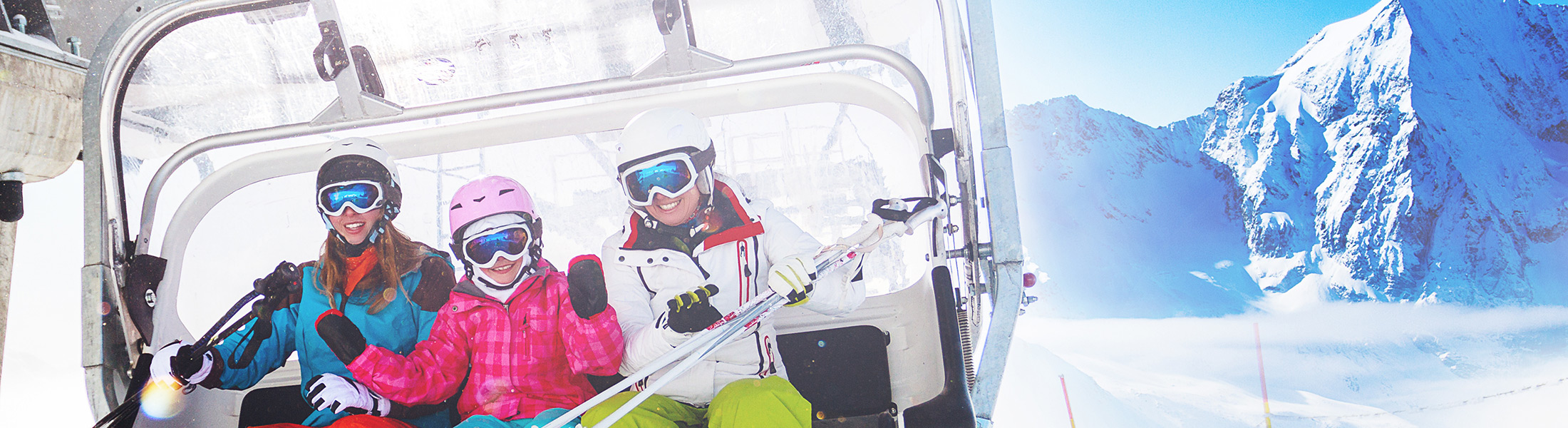Family on a chairlift on a ski holiday