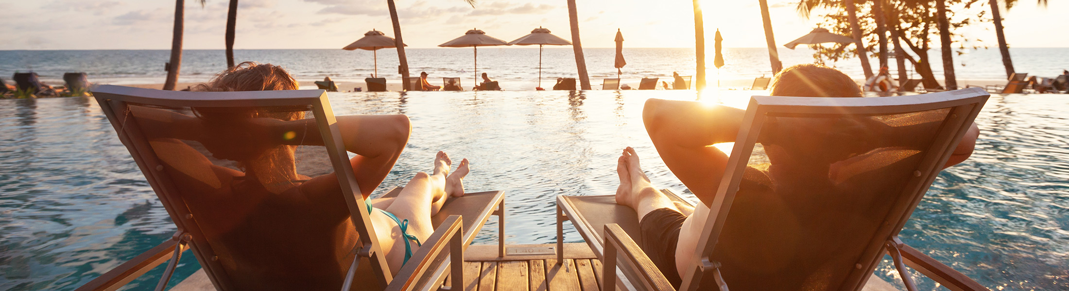 Couple in pool chairs on an adults only holiday
