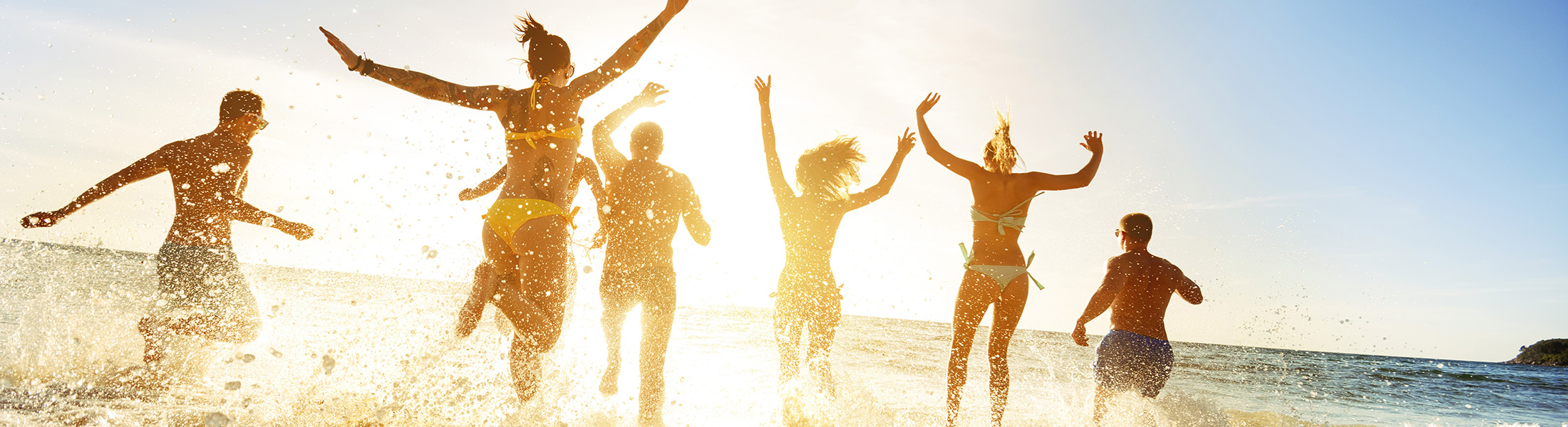 Group of friends at the beach on an adults only holiday
