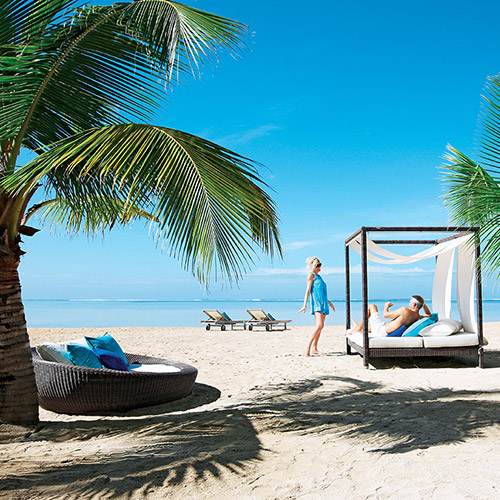 Couple in a beach cabana at Heritage Le Telfair Mauritius