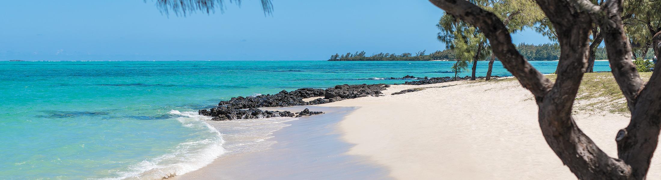White sand beach on the private island at Shangri-La's Le Touessrok Mauritius