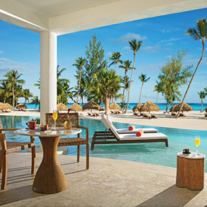 Terrace overlooking the swim out pool and beach at Secrets Cap Cana Resort & Spa in Dominican Republic