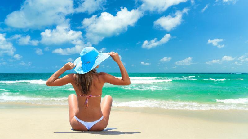 Woman on beach Caribbean