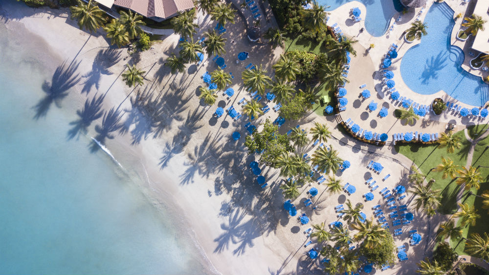 Aerial view of the beach and pool at St James Club Morgan Bay