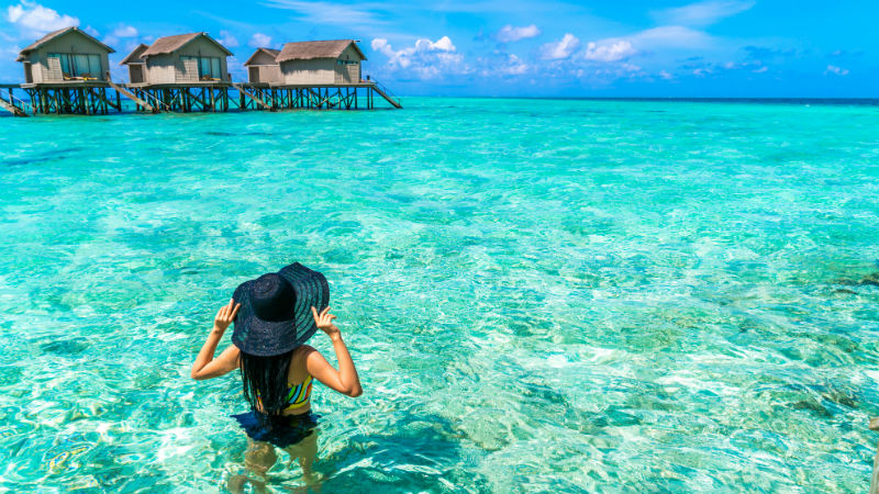woman at beautiful water villa