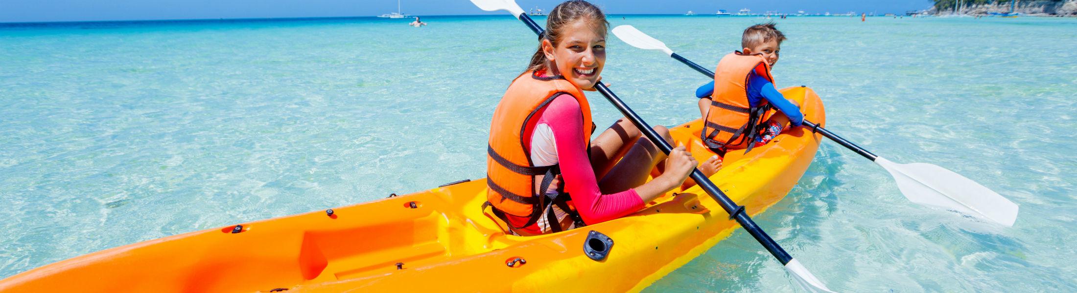 Children in a kayak in the Maldives