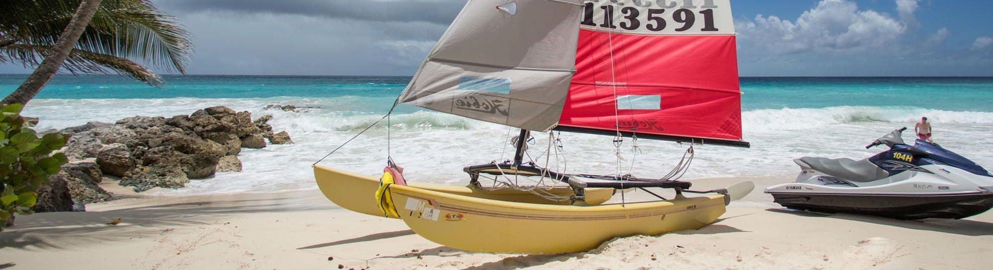 sailing boat at the Turtle Beach by Elegant Hotels