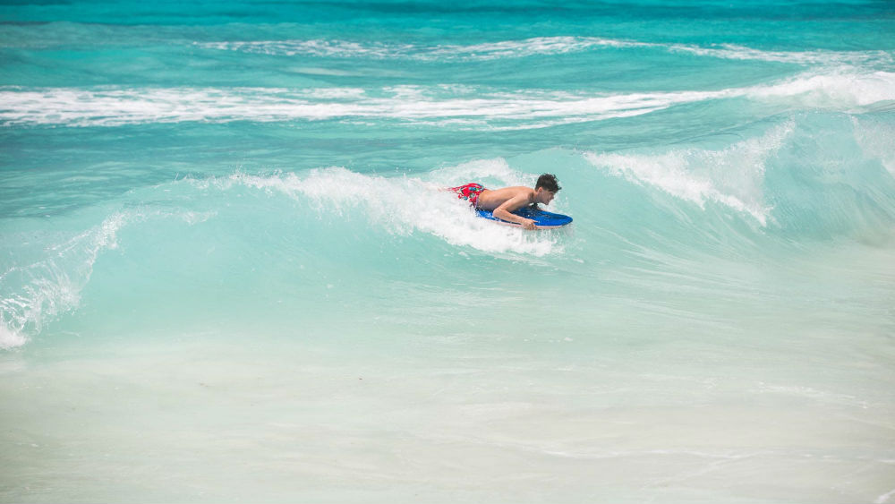 surfing at the Turtle Beach by Elegant Hotels