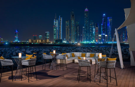 Outdoor dining at night at Manor House at One&Only The Palm