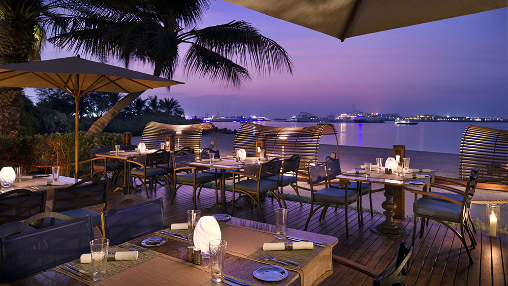 The Beach Bar at sunset at One&Only Royal Mirage The Palace