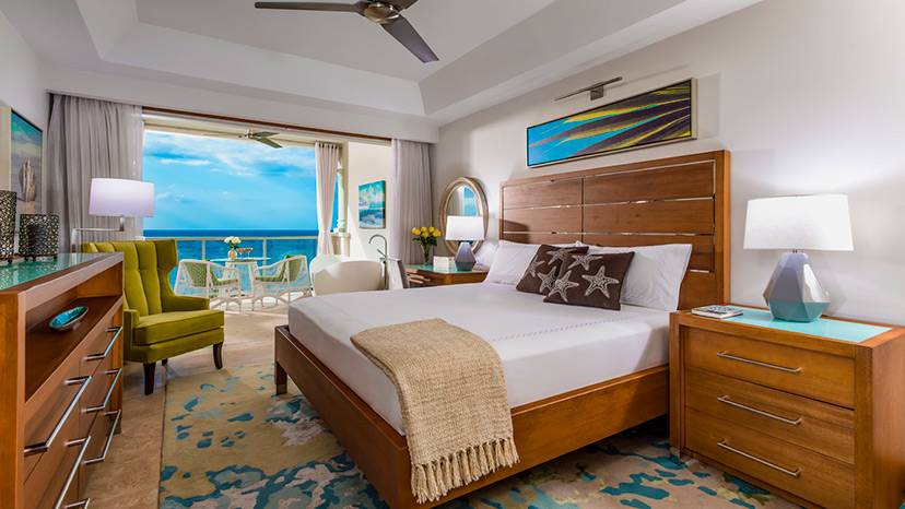 Bedroom of the Beachfront Grande Luxe Club Level Junior Suite at Sandals Montego Bay