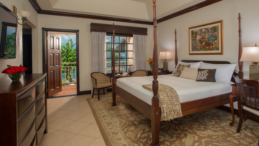 Four post bed in the Beachfront Honeymoon Club Level Junior Suite at Sandals Montego Bay