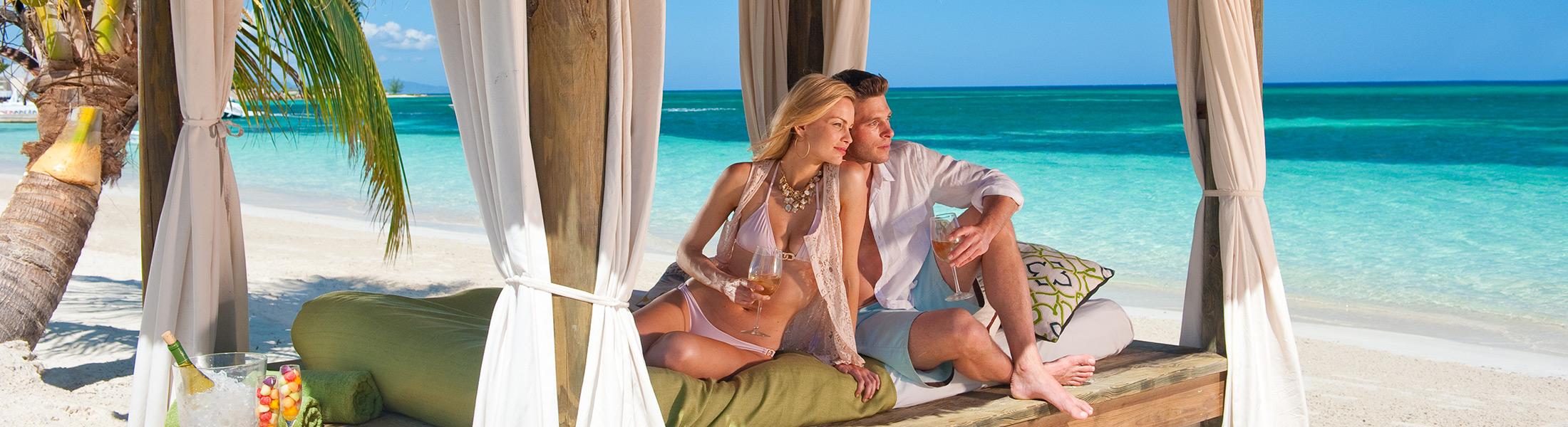 Couple on a beach cabana at Sandals Montego Bay