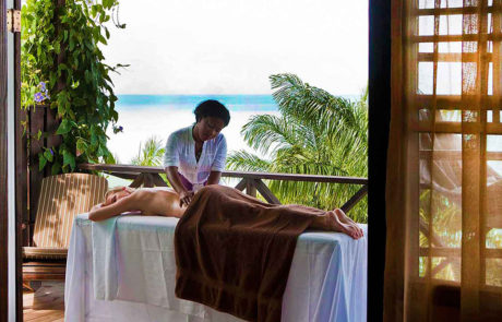 Woman receiving a massage at Cocos Hotel