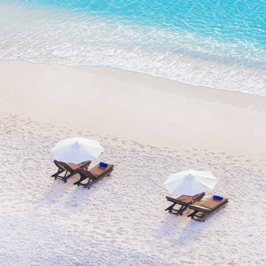 Sun loungers on the beach at Cocos Antigua