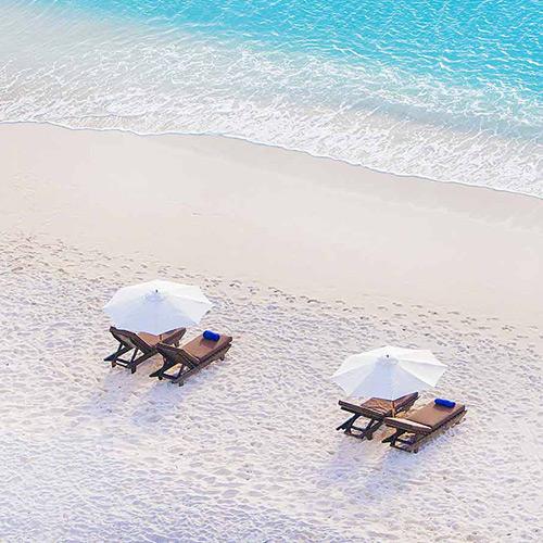 Sun loungers on the beach at Cocos Antigua