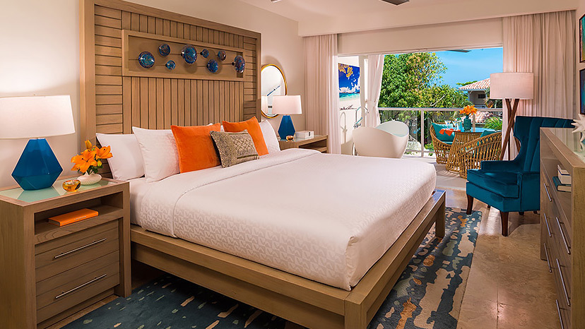 Bedroom of Crystal Lagoon Honeymoon Oceanview Luxury Room at Sandals Montego Bay