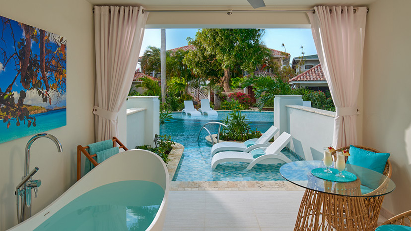 Patio of Crystal Lagoon Swim-Up Club Elite Luxury Room at Sandals Montego Bay