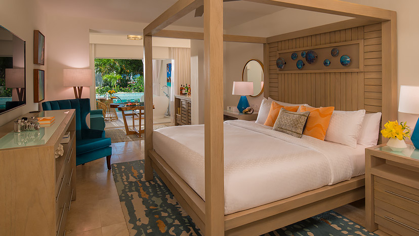 Bedroom of the Crystal Lagoon Swim-Up One Bedroom Butler Suite at Sandals Montego Bay