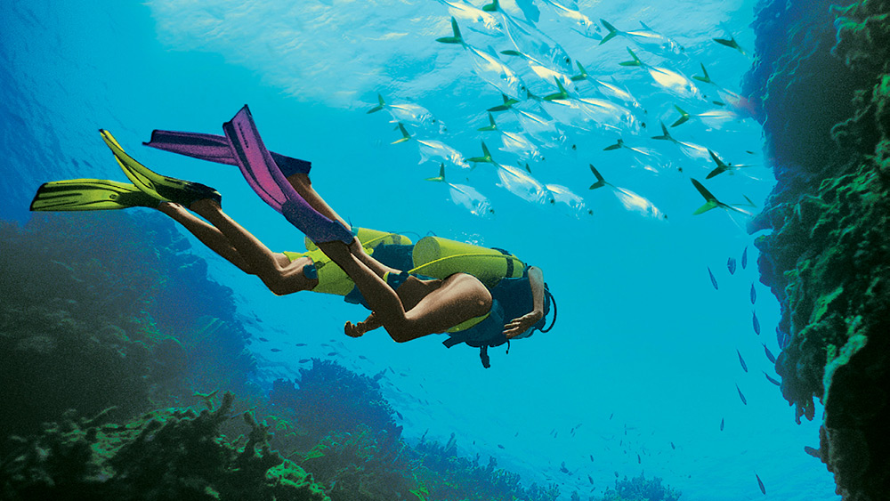 Couple diving at Sandals Montego Bay