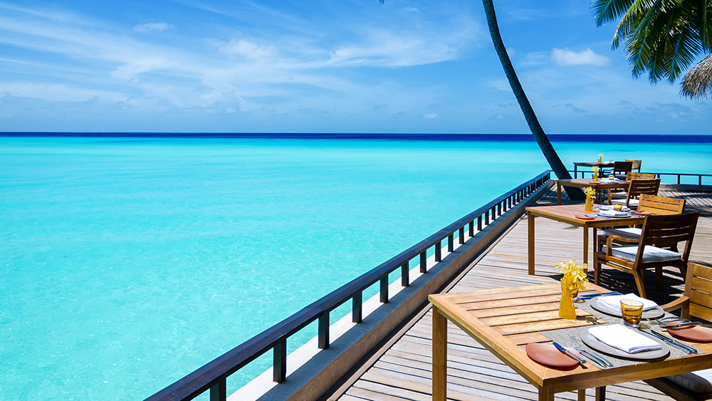 Restaurant balcony with sea view at One&Only Reethi Rah