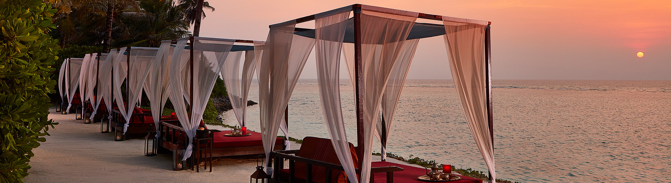 Cabanas at sunset at One&Only Reethi Rah