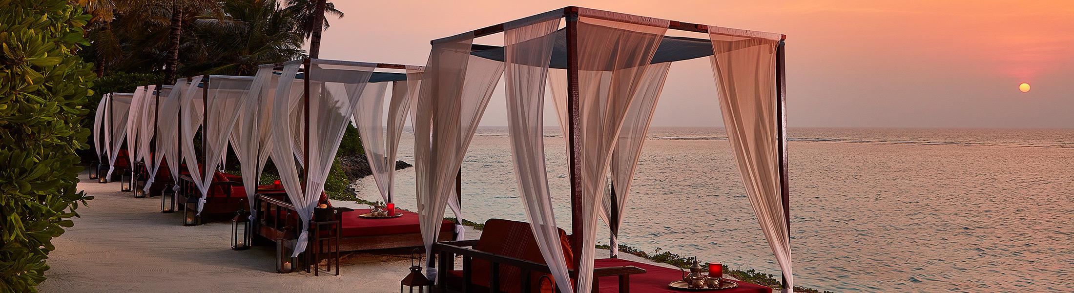 Cabanas at sunset at One&Only Reethi Rah