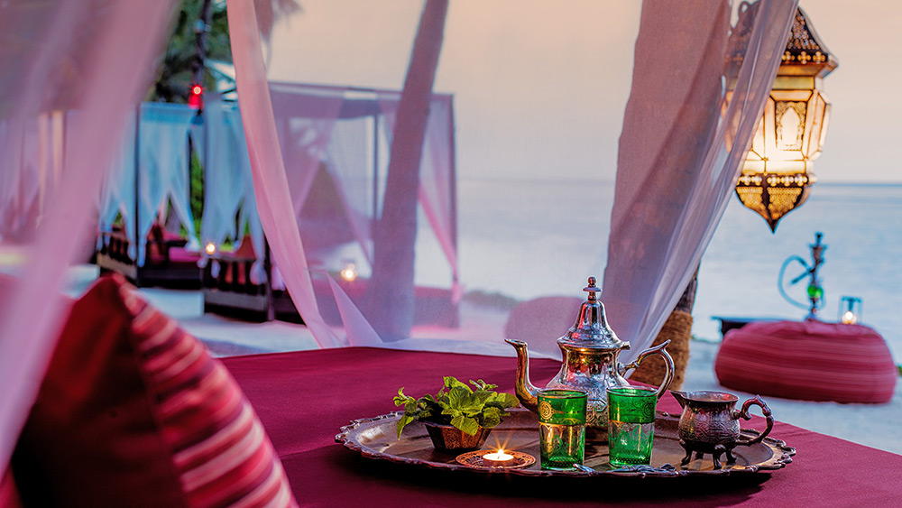Tea service at a beach sunbed at One&Only Reethi Rah