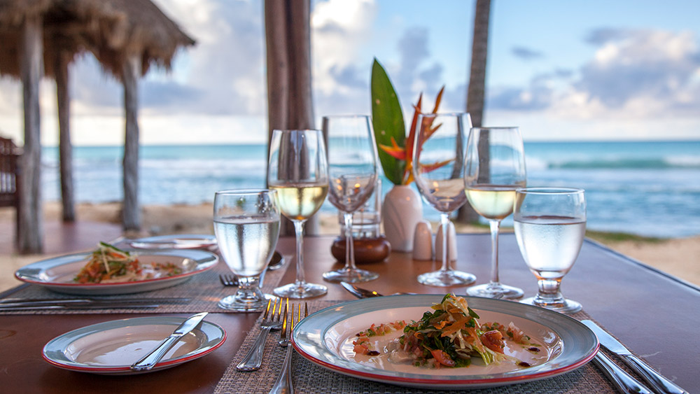 dinner setting with ocean views at Galley Bay Resort & Spa