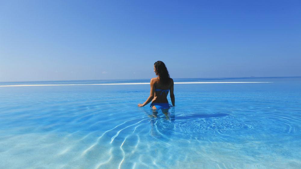 Girl Walking Into Pool Velassaru Maldives