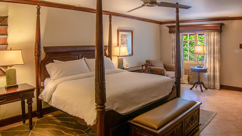 Four post bed in the Honeymoon Hideaway Premium Room at Sandals Montego Bay