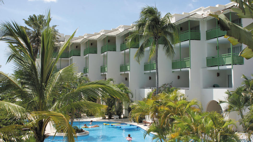 View of the pool and hotel exterior at Mango Bay