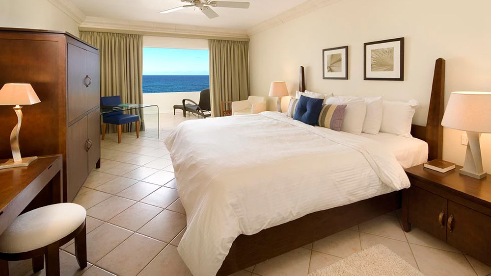 Bedroom of the Ocean Front Room at Mango Bay