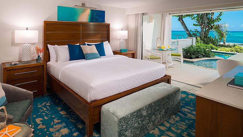 Bedroom of the Oceanfront Swim-Up Butler Suite at Sandals Montego Bay